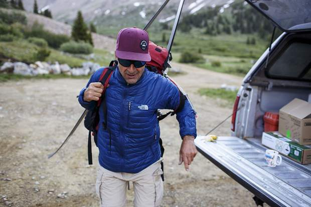 Summit County resident Gary Fondl, 50, puts on his backpack Thursday morning, June 29, near Montezuma.