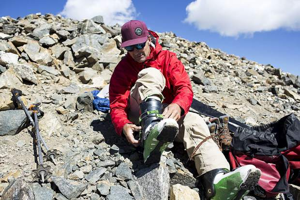 Boots on for descent on skis from the summit of Grays Peak Thursday, June 29, near Montezuma.