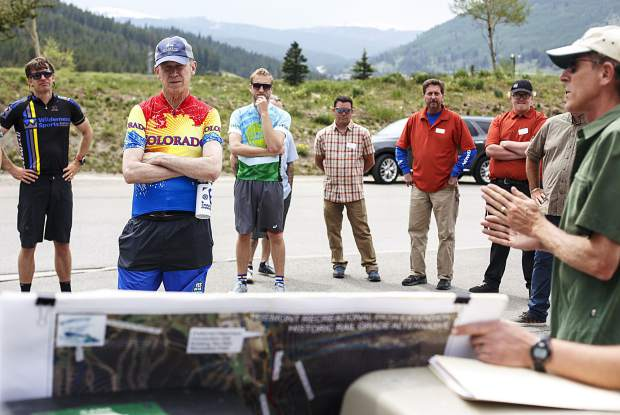 Colo. Gov. John Hickenlooper listens to a presentation about the Fremont Pass Recreational Pathway project Thursday, June 22, at Copper Mountain.
