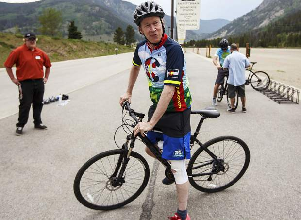 Gov. John Hickenlooper gets on a bike ahead of a ride with a group towards Frisco from Copper Mountain Thursday, June 22.