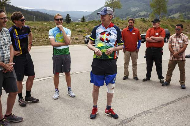 Gov. John Hickenlooper interacts with guests during a presentation about the Fremont Pass Recreational Pathway project Thursday, June 22, at Copper Mountain.