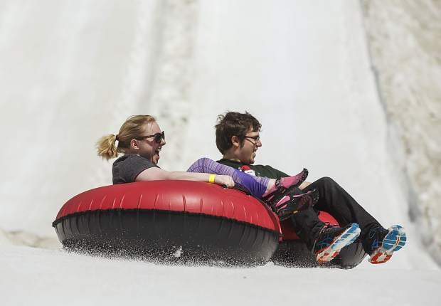 A pair of snow tube rider enjoy the ride down Tuesday, June 20, at Keystone Ski Resort.