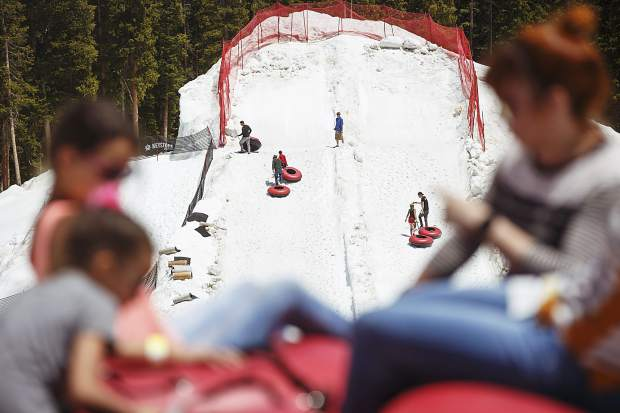 Guests disembark from the snow tubing lane from the bottom Tuesday, June 20, at Keystone Ski Resort.