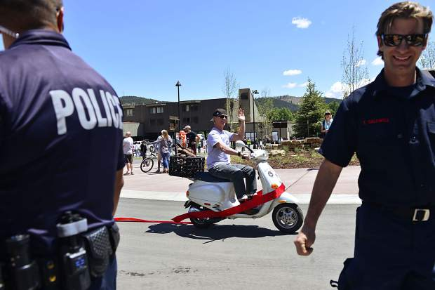Breckenridge Councilman Jeffrey Bergeron couldn't wait for the countdown as he jumps the gun and drives a scooter through the new roundabout at Park Avenue and Four O'clock Road on Friday in Breckenridge.