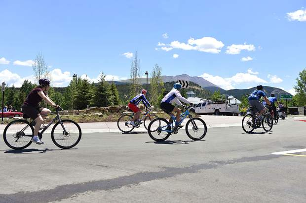 Bicycles were one of a number of different modes of transportation to take part in Friday's ribbon-cutting ceremony for a new roundabout at the heavily traveled intersection of Four O'clock Road and Park Avenue in Breckenridge.