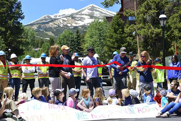 With children from the Mountain Top Children's Museum seated in front of him, Breckenridge Mayor Eric Mamula cuts a ribbon on Friday to officially reopen the intersection of Park Avenue and Four O'clock Road. The busy intersection reopened with a new roundabout just in time for the Fourth of July festivities in Breckenridge, and in addition to Mamula, state Rep. Millie Hamner and Councilwoman Wendy Wolfe spoke at the ceremony.