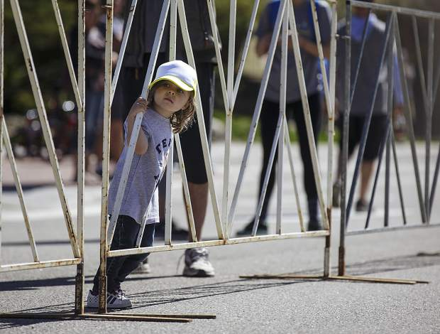 Marilla Poole, 3, watches runners pass by near the finish line during the Run the Rockies race in Frisco Saturday, June 3, 2017.