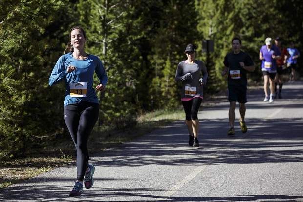 Run the Rockies participant Rachel Benedict, of Lakewood, runs on the recreation path during the 10K race between Copper Mountain and Frisco Saturday, June 3, 2017.