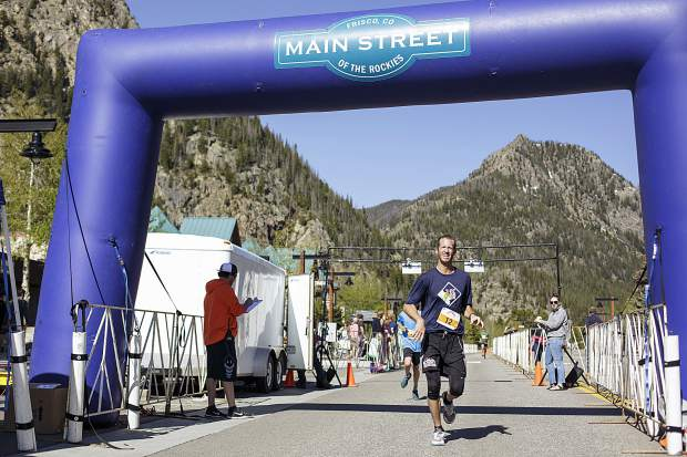 Run the Rockies participant Kevin Berrigan, of Silverthorne, cross the finish line during the 10K race in Frisco Saturday, June 3, 2017.