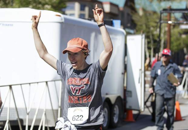 Fastest woman finisher for the Run the Rockies half-marathon race reaches the finish line Saturday June 3, 2017, in Frisco.
