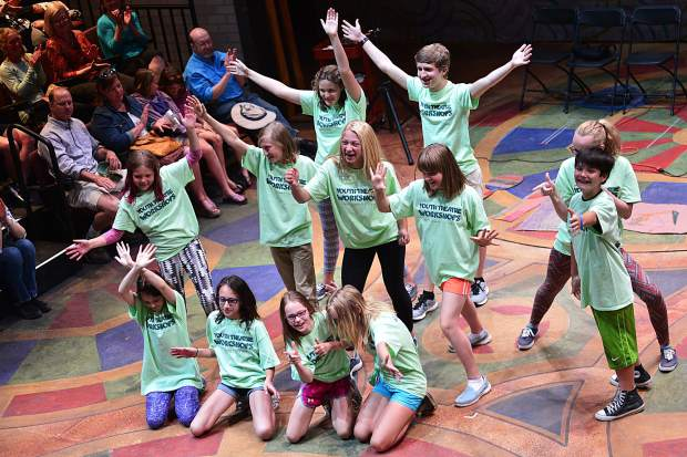 """Children perform Saturday before a packed crowd inside """"The Flex,"""" the largest of three indoor performance spaces at the Silverthorne Performing Arts Center, during a grand-opening celebration for the new $9 million facility."""