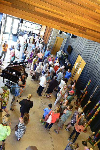 People mingle in the lobby inside the new Silverthorne Performing Arts Center at a Saturday grand-opening and ribbon-cutting ceremony.
