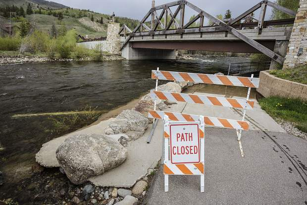 Roadblocks prevent access to the Blue River north of Silverthorne due to water overflow on the Recreational Path on Monday, June 5. Water levels are only expected to rise around Summit County through the end of this week.