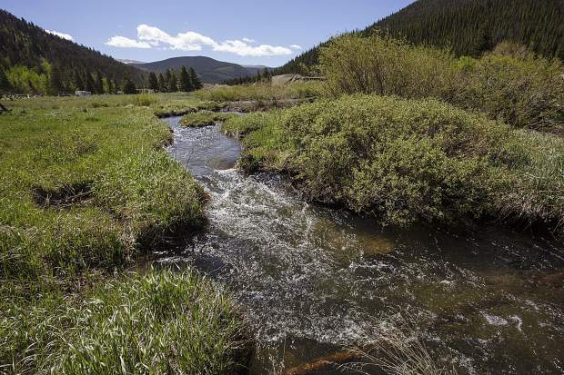 A section of the Swan River between the damaged upstream due to past dredge mining and the restoration project downstream as seen on Wednesday, June 14, near Breckenridge.