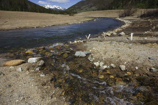 Spring meltoff flows into the lower Swan River on the county's restoration rroject area Wednesday, June 14, near Breckenridge.