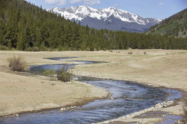 The Swan River is undergoing a decade-long restoration project to return it to a more natural alignment, as seen on Wednesday, June 14. Breckenridge's Tenmile Range can be spotted beyond.