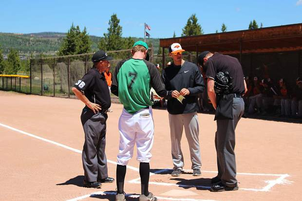 Coach Garrett Rieck exchanges lineup cards with the Eagle Valley Eagles coach prior to Saturday's first game.