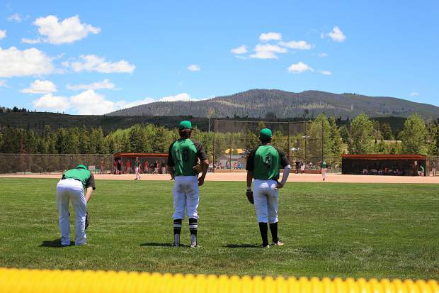 Outfielders Nate English (11), Cody Minnis (18) and Joshua Dolan (4) compare notes during a pitching change in Saturday's first game against the Eagle Valley Eagles.