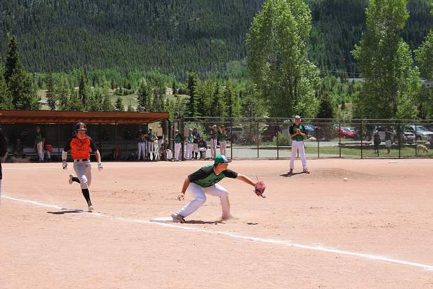 Summit's First baseman makes the stretch against Eagle Valley in Saturday's first game of the doubleheader.