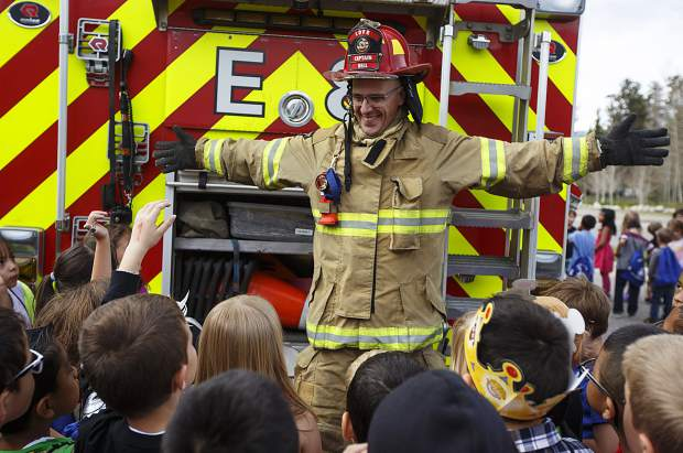 Lake Dillon Fire-Rescue Capt. Jason Bell leads a demonstration in front of Dillon Valley Elementary School students during an event at the school grounds Wednesday, May 31, 2017, in Dillon. The local law enforcement and fire departments were visiting a community event, in which the Elements Church were giving away 400 pairs of brand-new slip-on shoes to students as a way to give back to the community.