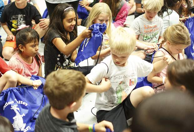 Dillon Valley Elementary School kindergarten students check out their brand new slip on shoes donated by Elements Church Wednesday, May 31, 2017, in Dillon. The church partnered with Dillon Valley Elementary to give away 400 pairs of shoes to students at the school as a way to give back to the community.