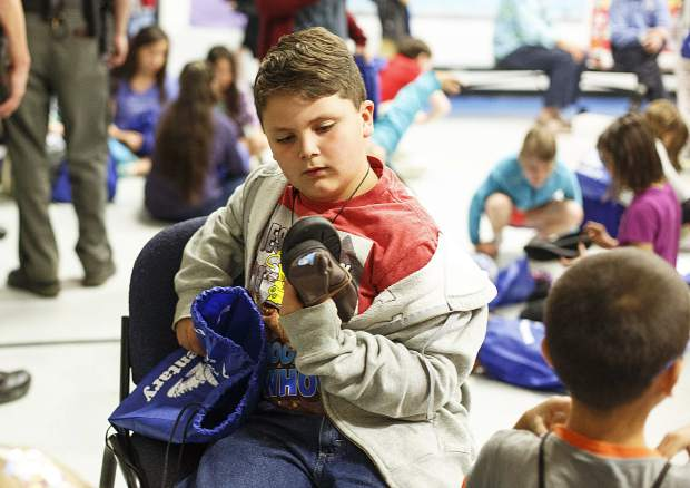 Dillon Valley Elementary School second-grader student Max Clawson check out his brand new slip on shoes donated by Elements Church Wednesday, May 31, 2017, in Dillon. The church partnered with Dillon Valley Elementary to give away 400 pairs of shoes to students at the school as a way to give back to the community.