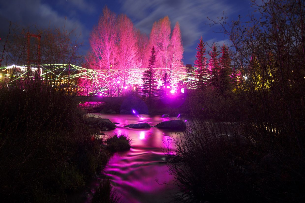Ropes of multi-color LEDs is illuminated along the Blue River in Breckenridge, for the