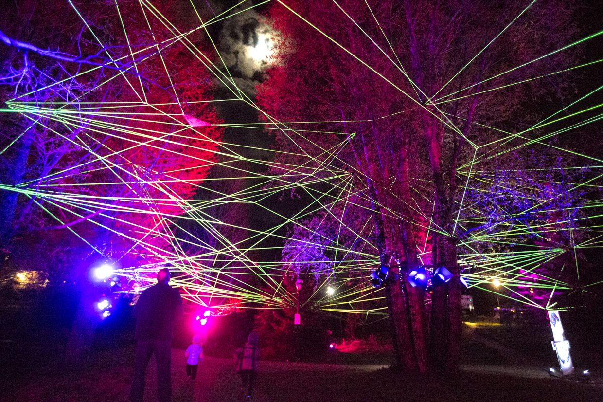 Ropes of multi-color LEDs is illuminated north of Dredge Pond, the