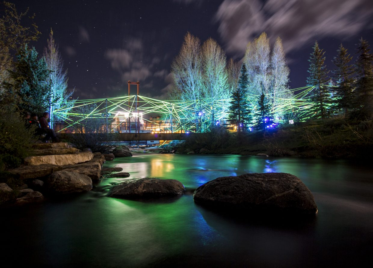 Ropes of multi-color LEDs is illuminated along the Blue River, for the