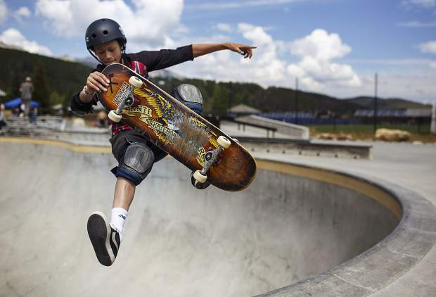 Collin Hyon, 14, catches air above the bowl during the Battle On The Blue skateboard competition Saturday, July 22, at the Breckenridge Skate Park in Breckenridge.