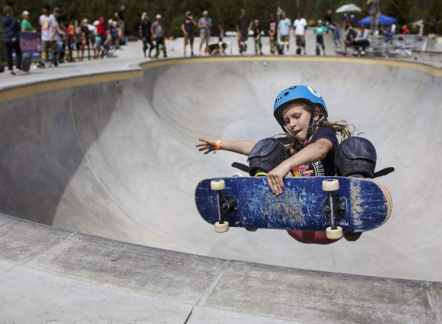 Early Boggs, 10, catches air above the bowl during the Battle On The Blue skateboard competition Saturday, July 22, at the Breckenridge Skate Park in Breckenridge.