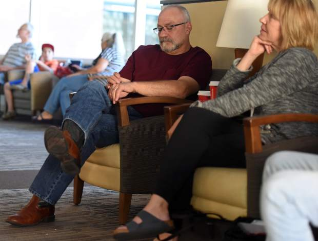 Robert Pachl waits next to wife, Tamara, before surgery begins May 31 for their daughter, Layne, and Sandi Elder at the University of Colorado Hospital in Aurora.