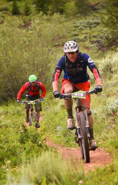 A duo of riders kicks it into overdrive for the final stretch of brush-lined singletrack near Tiger Dredge on loop two of the Breck 100 on July 29. The event drew nearly 300 riders from across the world for 32, 68 and 100 mioles of riding in constant rain and chilly temperatures.