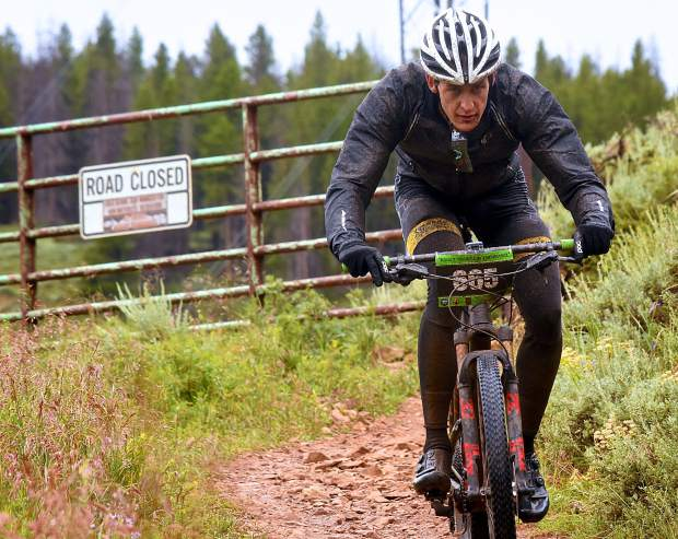 A rider leaves the Colorado Trail portion of the Breck 100 for the Gold Run Road portion of loop two at the 13th annual ultra-endurance race in Breckenridge on July 29. The event drew nearly 300 riders from across the world for 32, 68 and 100 mioles of riding in constant rain and chilly temperatures.