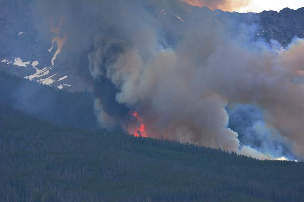 Flames reached heights of 125 feet on Wednesday as a wildfire ripped up the forest near Peak 2.