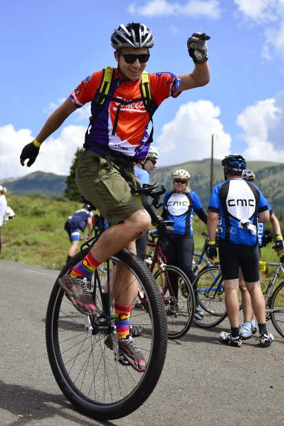Riding for his sister, Martha, Sean Riedel balances on his unicycle while taking a short break atop Vail Pass during the 2017 Courage Classic, a bicycle tour in support of Children's Hospital Colorado.
