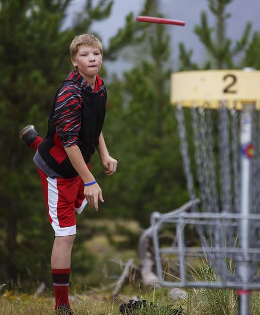 Disc golfer Brecken Perlow, of Breckenridge, attempts to sink a birdie in the basket Friday, July 28, in Frisco
