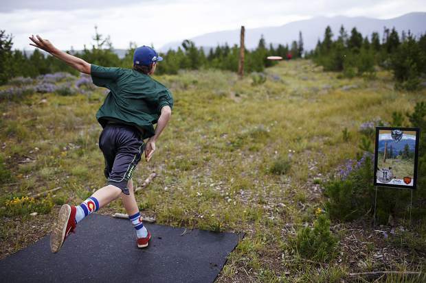 Peak One Championships competitor Dylan Perlow, of Breckenridge, sends the disc to Hole 11 basket Friday, July 28, in Dillon.