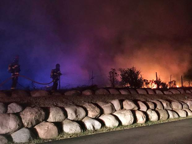 The fire burned about a half acre before fire fighers and emergency responders from several agencies were able to knock it down.
