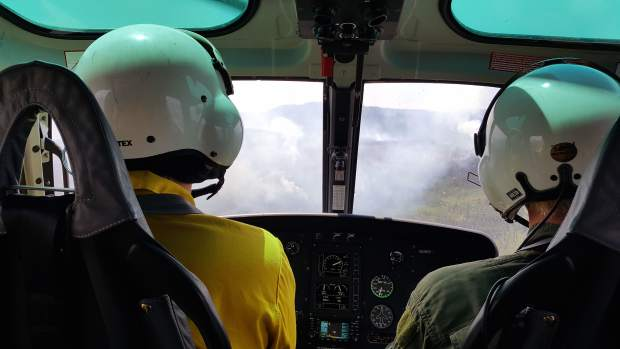 This is what a wildland fire looks like when you're flying a helicopter into it. These Forest Service flyers are measuring the Gutzler fire. It grew to more than 1,000 acres of mostly dead and downed timber.