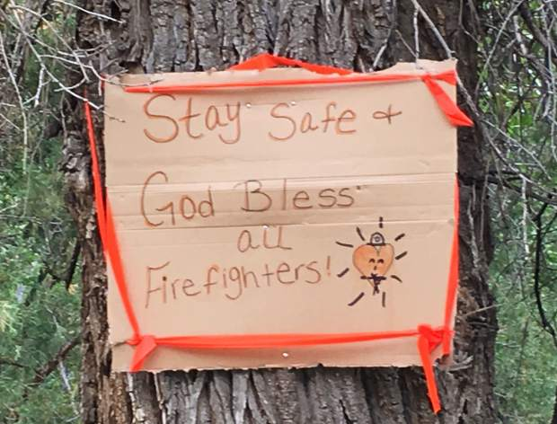 Well-wishers left a note for the more-than175 fire fighters battling the Gutzler fire.