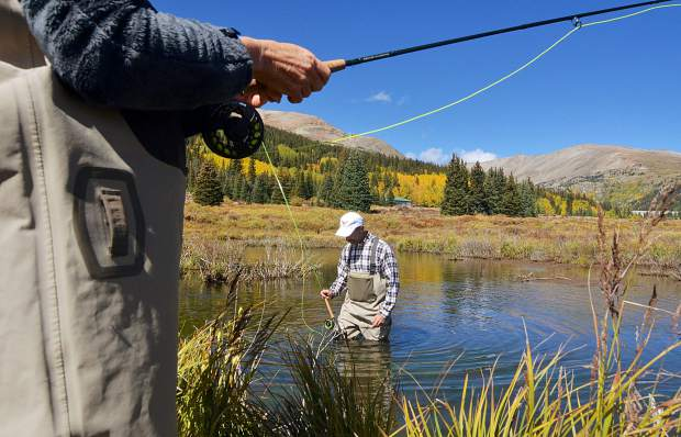 Jon Ventura (center) wades through a shallow pool on the Middle Fork of the South Platte River outside of Alma during a two-hour intro fly-fishing trip on Sept. 16.