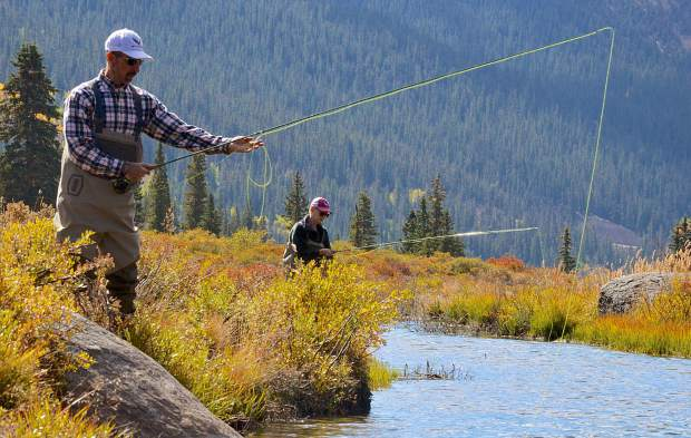 Jon (left) and Donna Ventura of Los Alamos, New Mexico work on casting technique during an introductory fly-fishing trip to the South Platte River in 2016. Headwaters for the Middle Fork of the South Platte begin just south of Hoosier Pass and are teeming with aggressive brown trout during the autumn spawning season, where most fishing is catch-and-release in accordance with conservationist Bud Lilly's work.
