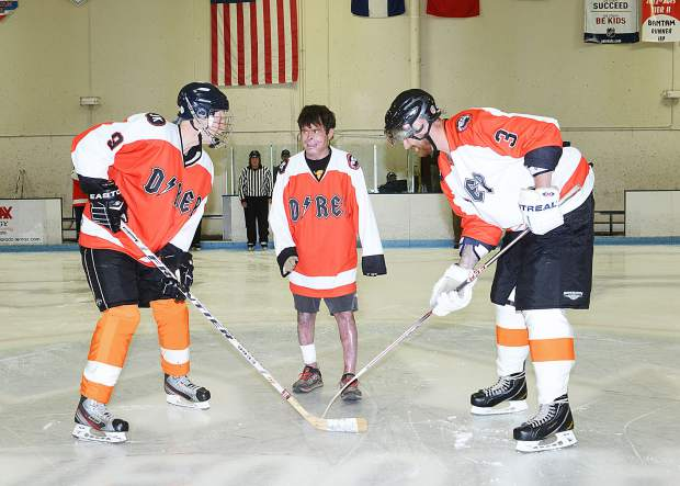 Dave Repsher, center, dropped the puck for the Dawg Nation Hockey Foundation's annual Survivor Game in Littleton, Colorado, the last weekend of June. Both teams wore sweaters bearing Repsher's nickname D-Rep in honor of the critically injured Flight For Life flight nurse.