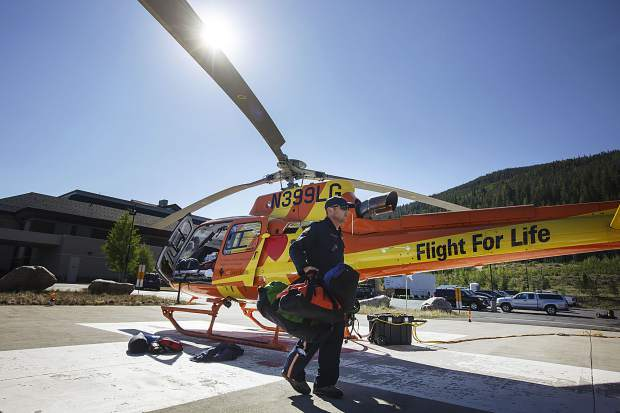 Flight For Life paramedic Tim Baldwin prepares for a flight on Sunday, July 2, at St. Anthony Summit Medical Center in Frisco. Monday marks the two-year anniversary of the life-saving copter's crash near the site in 2015.