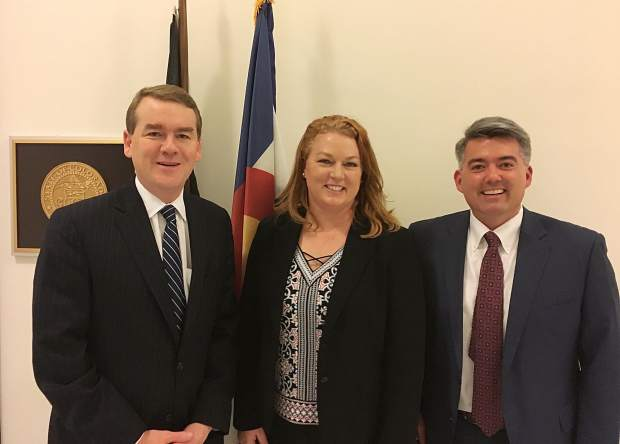 Since losing her husband Patrick in the 2015 Flight For Life helicopter crash, Karen Mahany has made federal aviation safety advocacy a primary mission of her life moving forward. Here she poses with U.S. Sens. Michael Bennet, left, and Cory Gardner, right, both of Colorado.