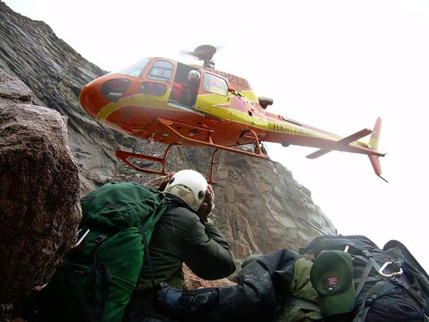 Patrick Mahany assisted with countless rescues during his career as a pilot with Flight For Life that started in 1987. Here he maneuvered his helicopter uncomfortably close to a cliff face while helping the Summit County Search Group with a mission to provide aid to an injured hiker on Longs Peak in Rocky Mountain National Park.