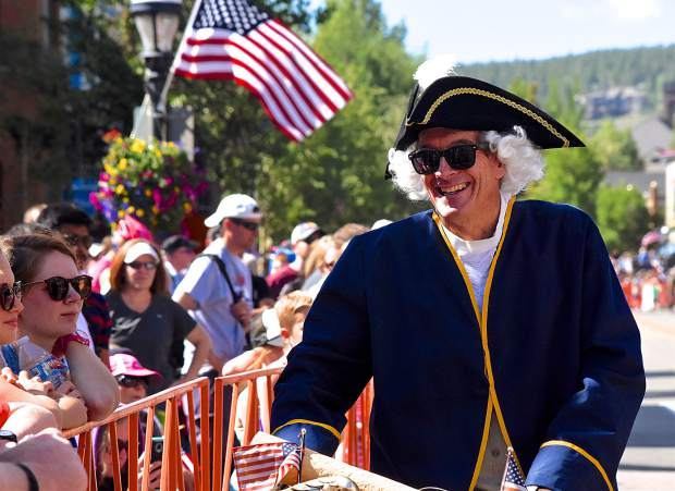 Local celebrity CJ Mueller, a one-time world-record holder for speed skiing, laughs with the crowd before the start of the Breckenridge Fourth of July parade on Main Street. Mueller donned his annual George Washington regalia to bike along the parade route and give a parade-ending address.