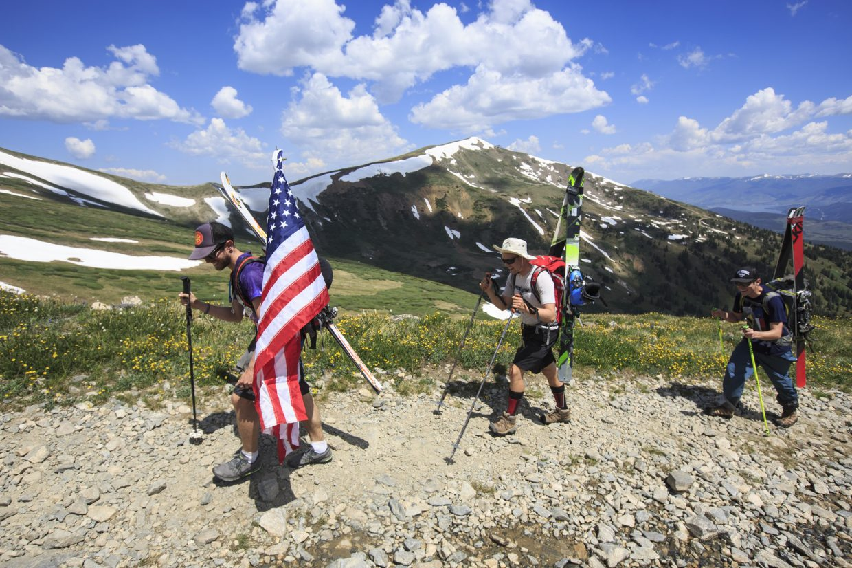 Skiers ascend towards Fourth of July Bowl Tuesday, July 4, on Peak 10 near Breckenridge.