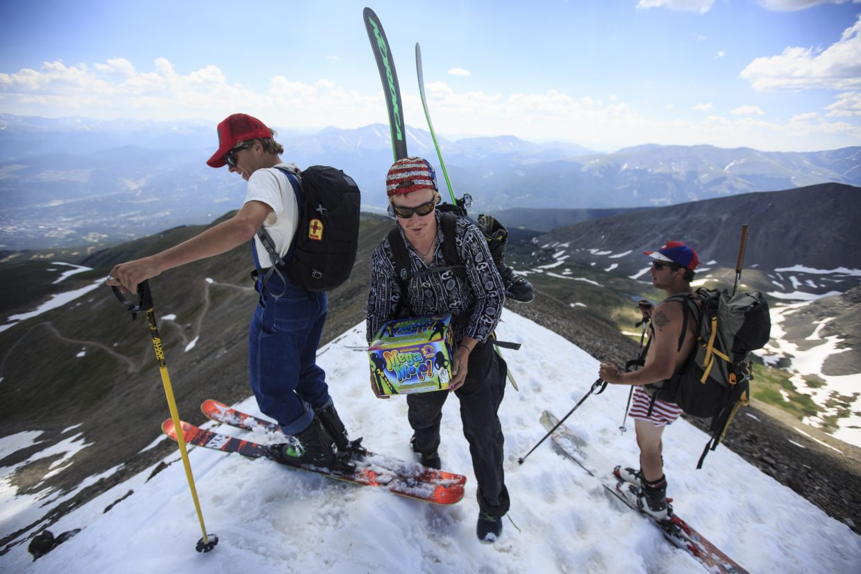 A skier carries a box of fireworks to the top of Fourth of July Bowl Tuesday, July 4, on Peak 10 near Breckenridge.